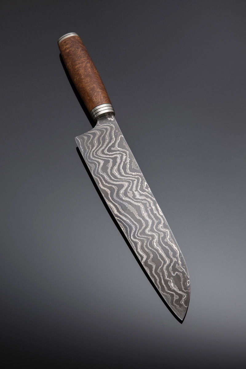 Damascus Gyuto w Brown Mallee burl handle w Nickel silver spacers, end cap and guard; blade length is 255mm. Price for similar is $1100