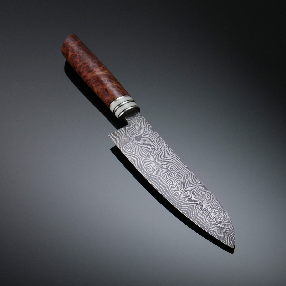 Damascus Gyuto w Red Mallee burl handle with Corian and Nickel Silver spacers and guard; blade length is 180mm. Price for similar is $900