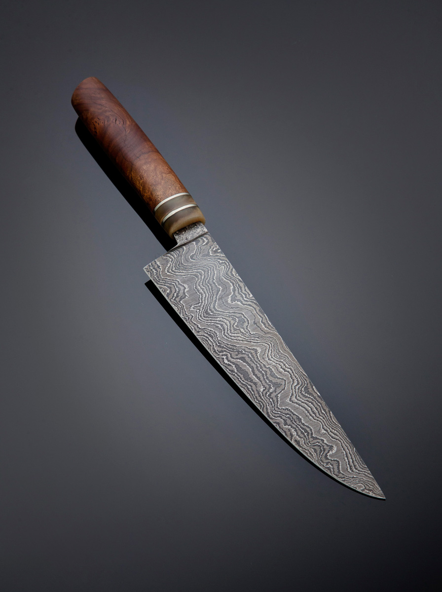 Damascus kitchen knife w Red Morrell handle and Stainless steel and Ram's horn spacers and guard; blade length is 195mm. Price for similar is $800