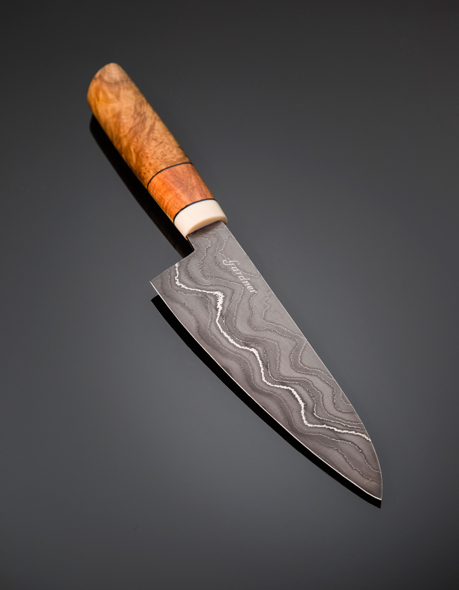 Damascus Gyuto w Yellow Mallee burl and Brown Mallee burl handle with a Corian guard; blade length is 200mm. Price for similar is $850