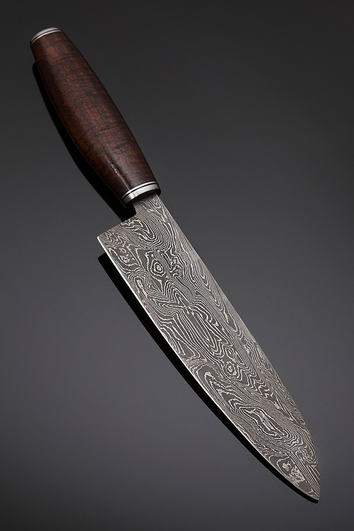 Santoku in Damascus steel, Handle – Ringed Gidgee with stainless guard & end cap, Overall length 330mm, Blade length 195mm, Price for similar $900